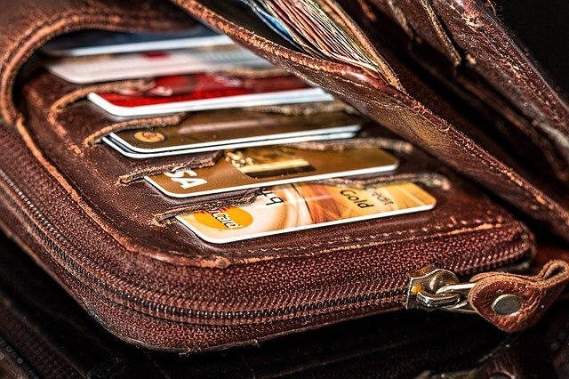 Image of a wallet filled with credit cards, representing how Harwood Legal, PLLC can help you understand and navigate the effects of bankruptcy in WV.