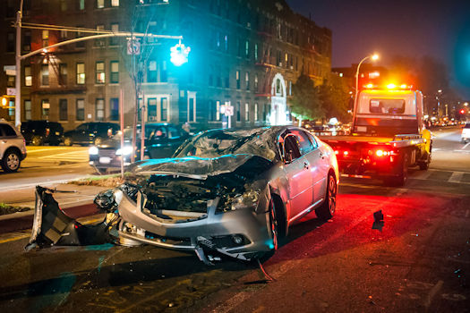 An image of a car wreck, representing how a Logan County car wreck lawyer at Harwood Legal PLLC provides legal guidance and representation to maximize your compensation.