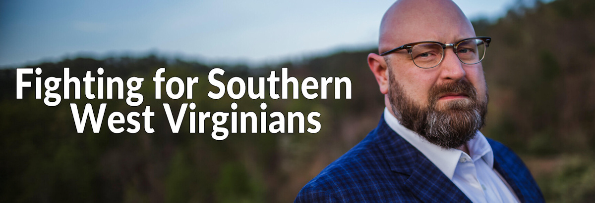 Image of Jason Harwood standing in front of the beautiful mountains of WV, representing the area he calls home and proudly serves the hardworking people in his area.