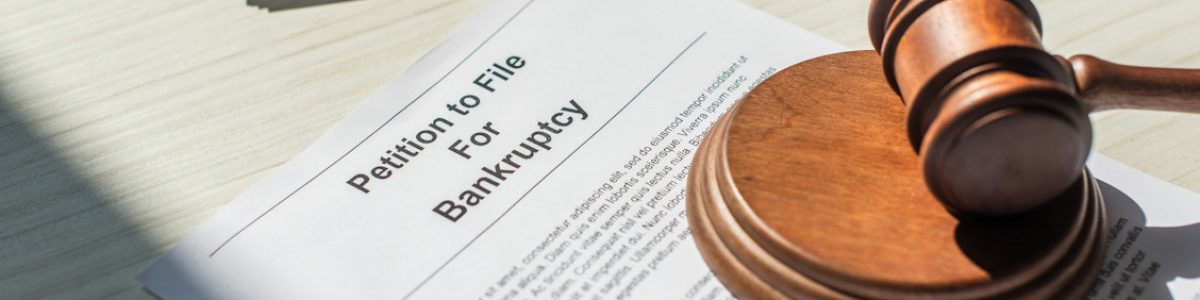 Image of gavel laying on top of a Petition to File for Bankruptcy file, representing how Harwood Legal, PLLC can help debtors file for bankruptcy in WV.