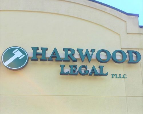 Outside image of the Harwood Legal storefront, representing the office a client can come to when looking for an experienced, compassionate, skilled hometown attorney in Southern WV.
