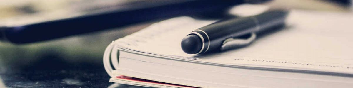 Image of a black pen and notebook, representing the hard work and dedication you will receive from Jason Harwood. He's the one to call when you need a lawyer in Southern WV.