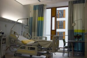 Image of an empty hospital bed, representing the need to consult Logan County personal injury lawyer Jason Harwood of Harwood Legal for experienced representation in personal injury cases in WV.