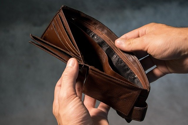 Image of two hands opening an empty wallet, illustrating how Jason Harwood at Harwood Legal can help when if you're considering or have filed bankruptcy in WV.